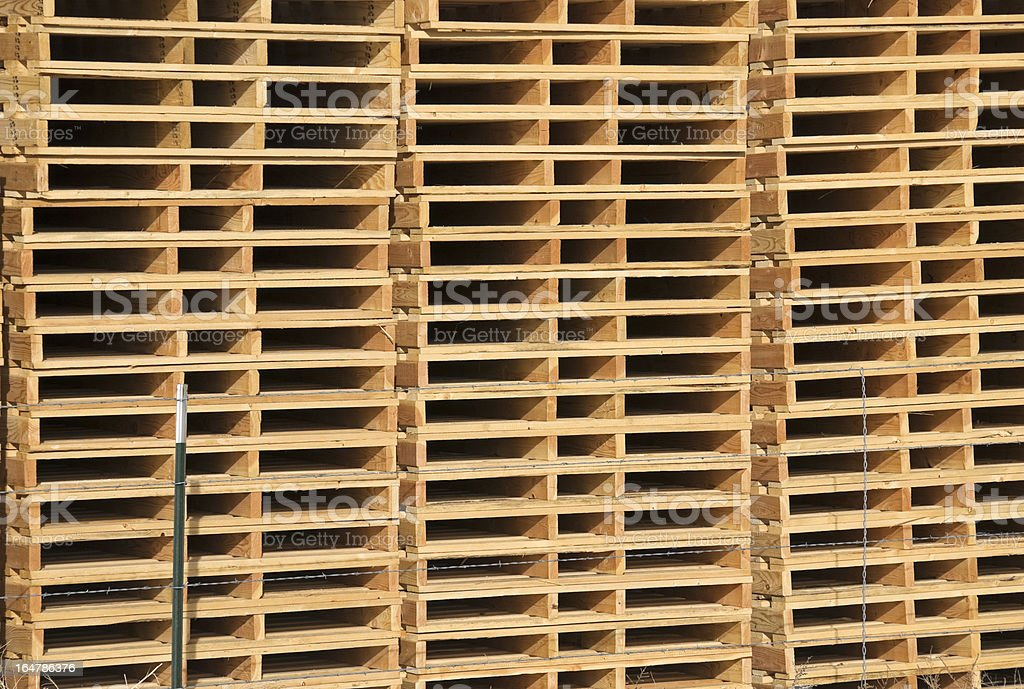 Stacked wooden pallets or skids royalty-free stock photo