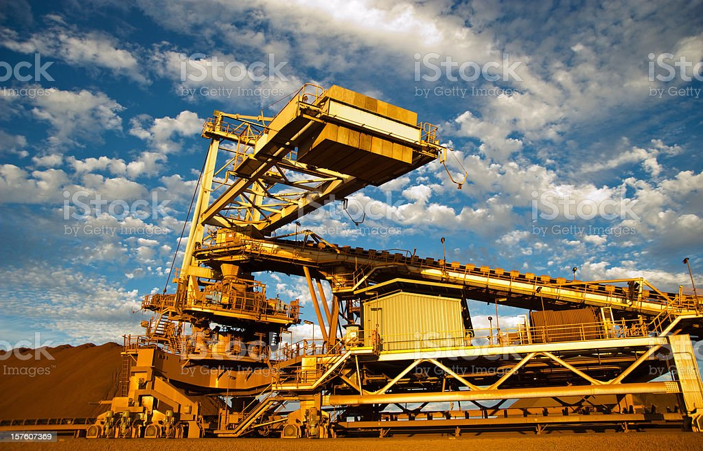 Stacker and stockpile in iron ore mine site stock photo
