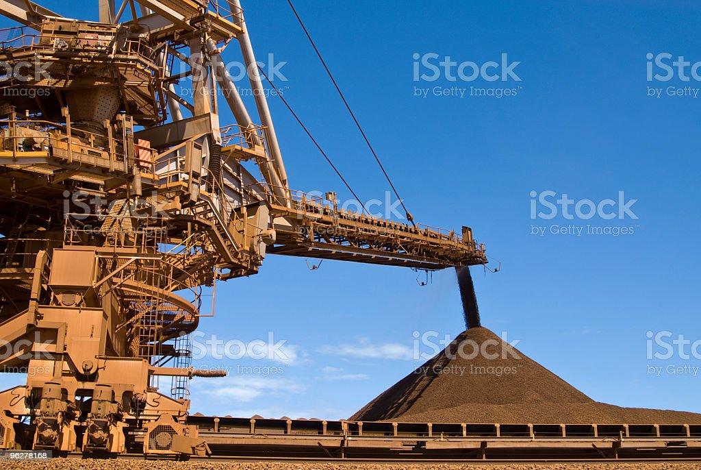 Stacker and Stockpile on Iron Ore Mine Site stock photo