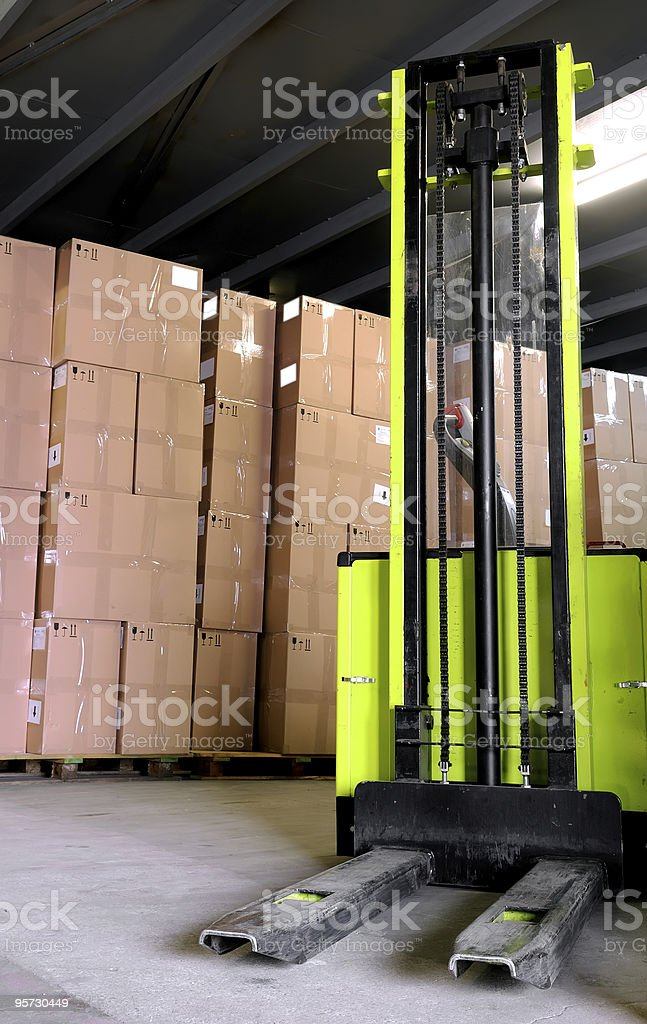 stacker in warehouse royalty-free stock photo