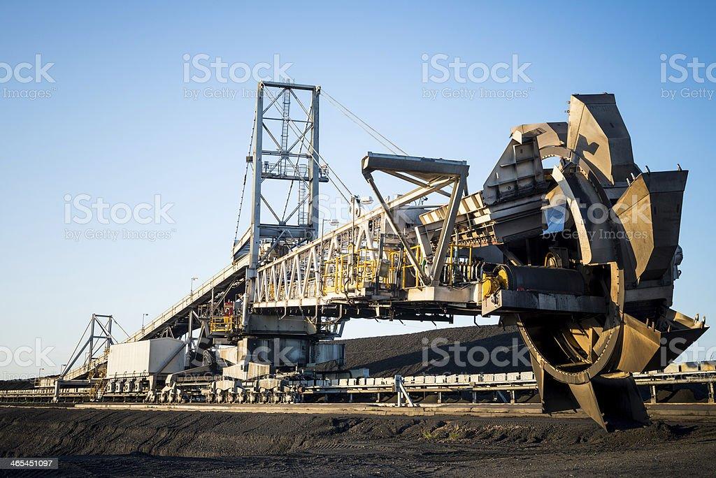 stacker reclaimer on coal stockpile stock photo
