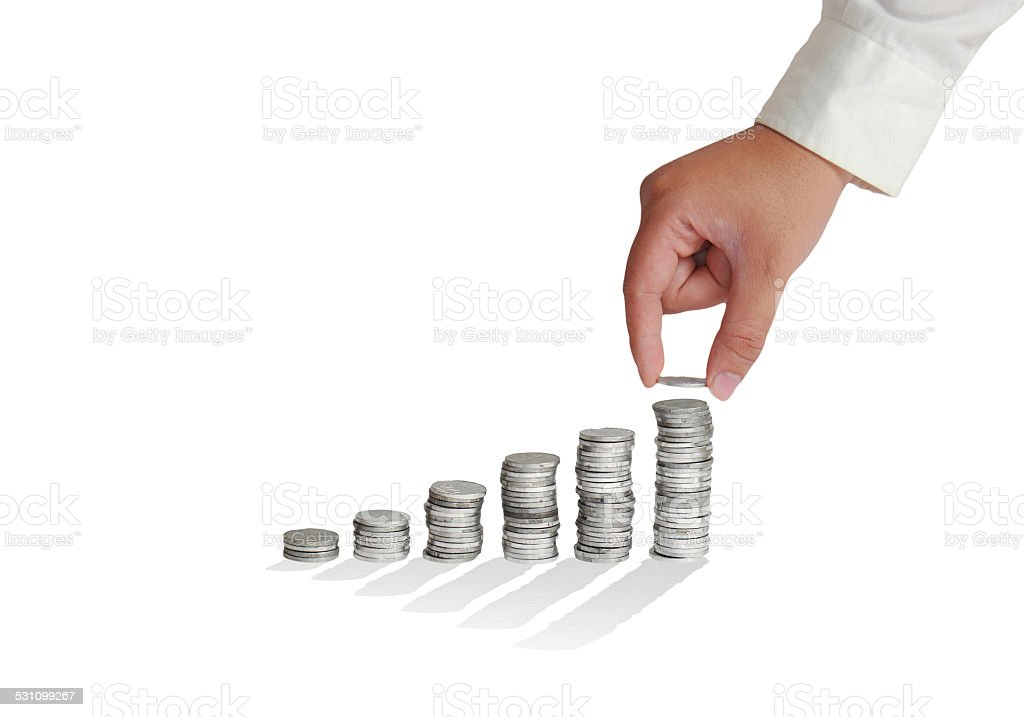 Stacking Coins into Ladder stock photo