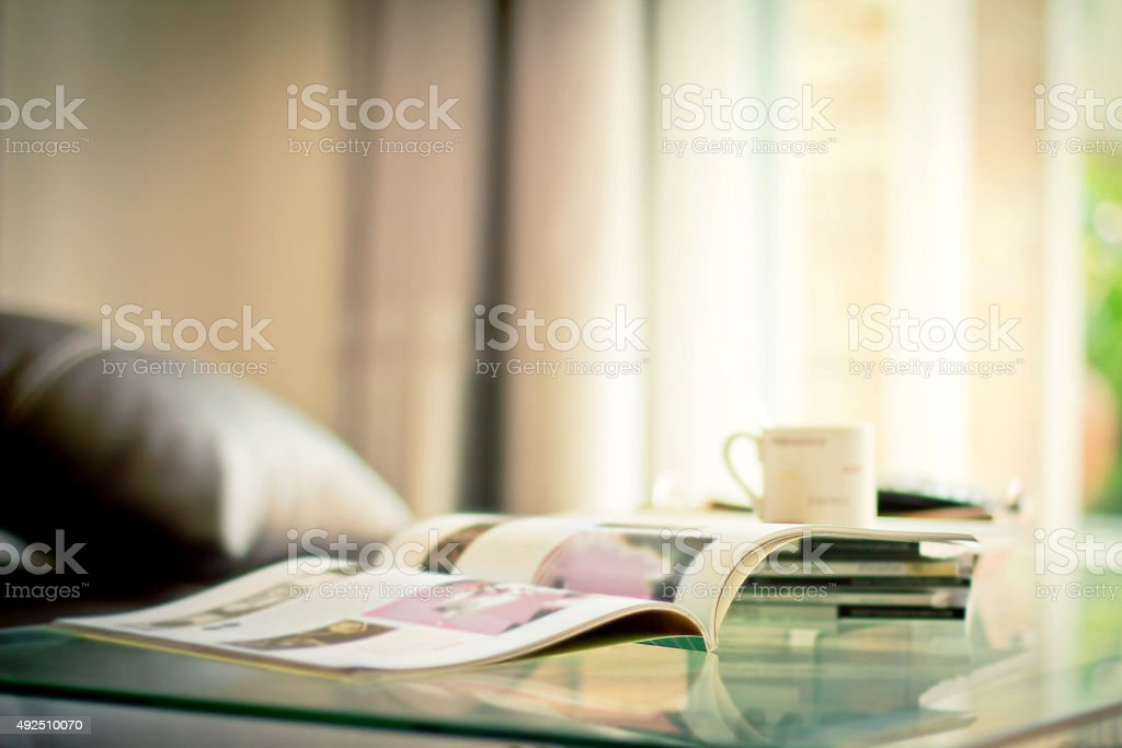 stacking magazine place on table in living room stock photo