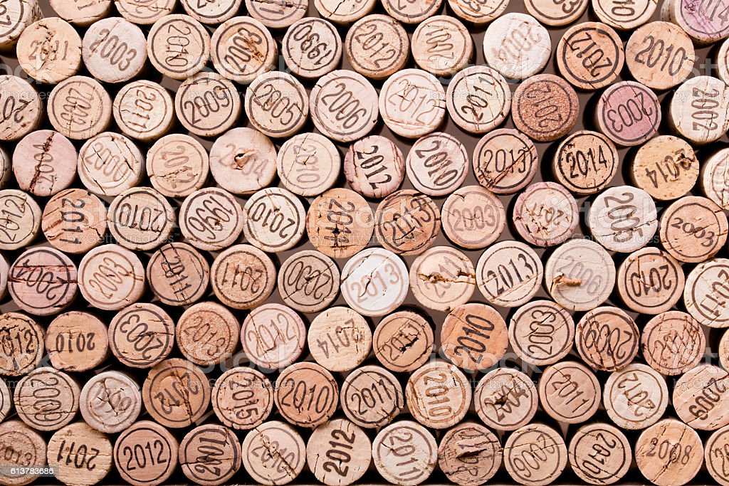 stacking of wine cork background with vintage years stock photo