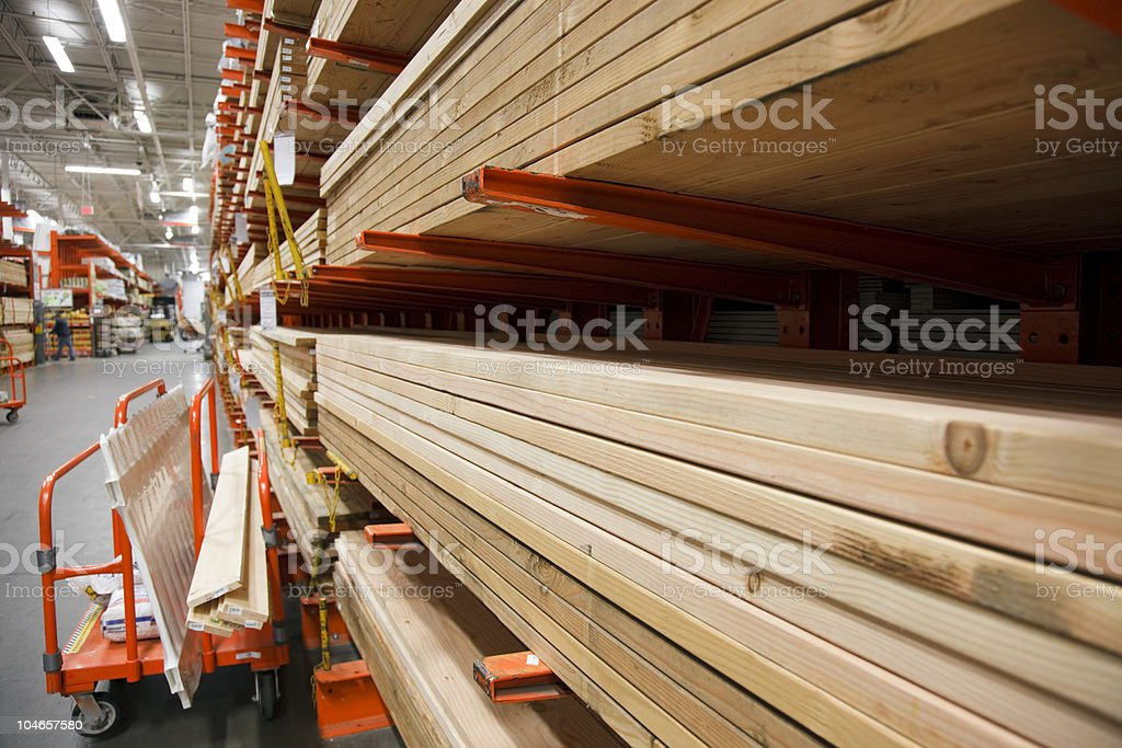 Stacks and stacks of lumber in a large warehouse stock photo