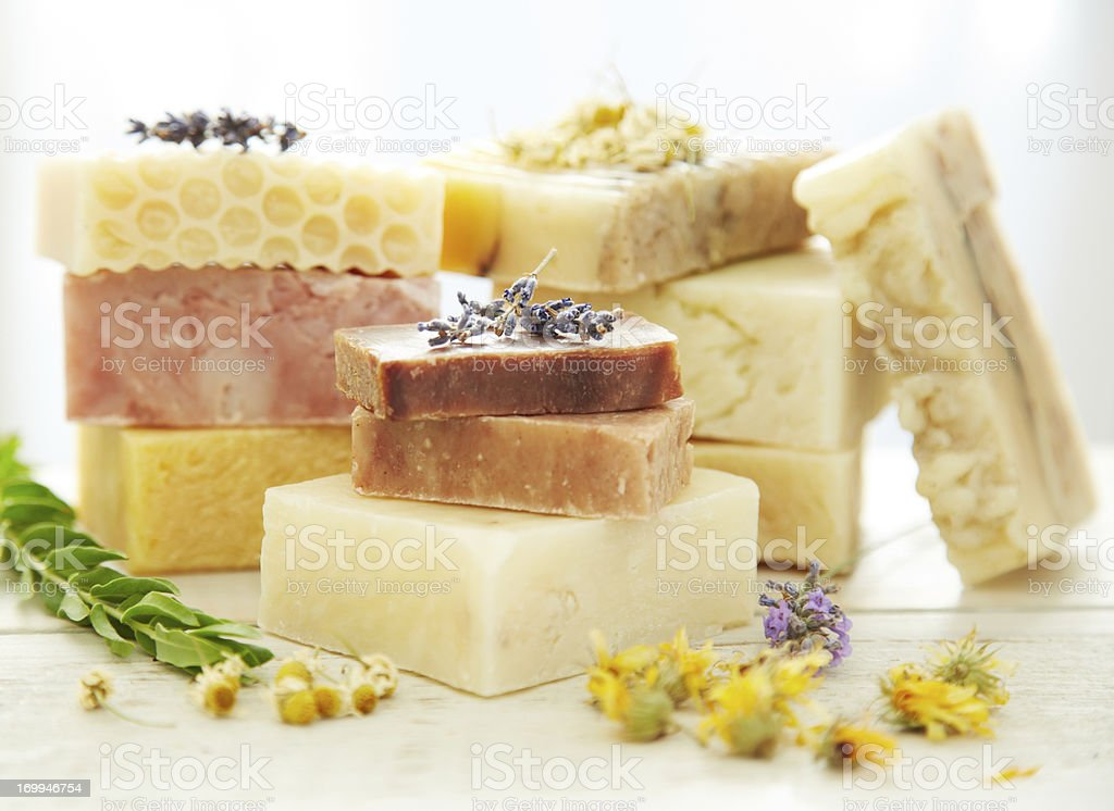 Stacks homemade organic bars of soap with lavender on top stock photo