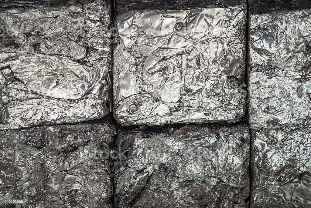 Stacks of aluminium blocks at recycling yard stock photo