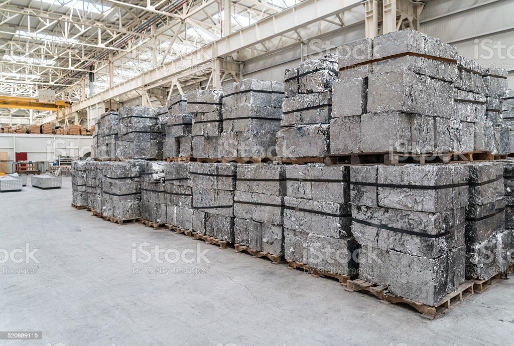 Stacks of aluminium blocks stock photo