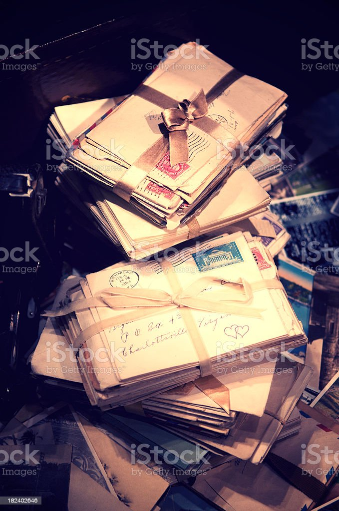 Stacks of Antique Love Letters Wrapped in Shiny Bows stock photo