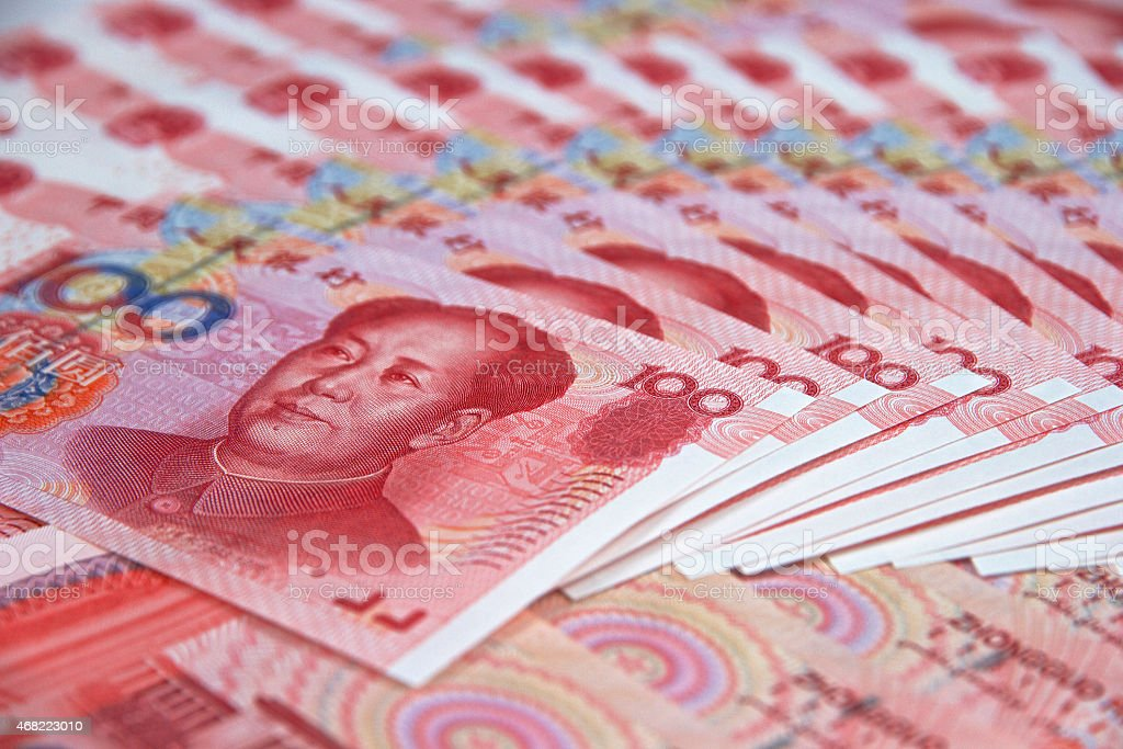 Stacks of Chinese currency, Yuan Renminbi (RMB), value 100 stock photo