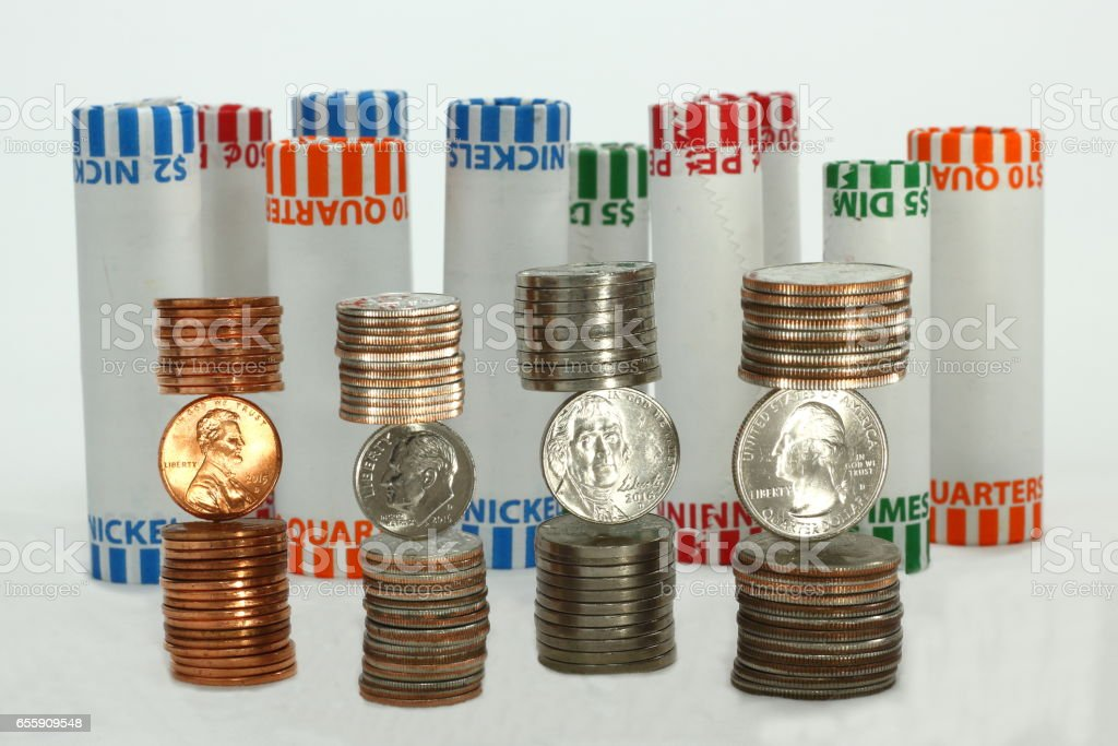 Stacks of Coins and Rolled Coins stock photo