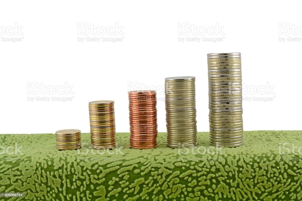 Stacks of coins white background stock photo