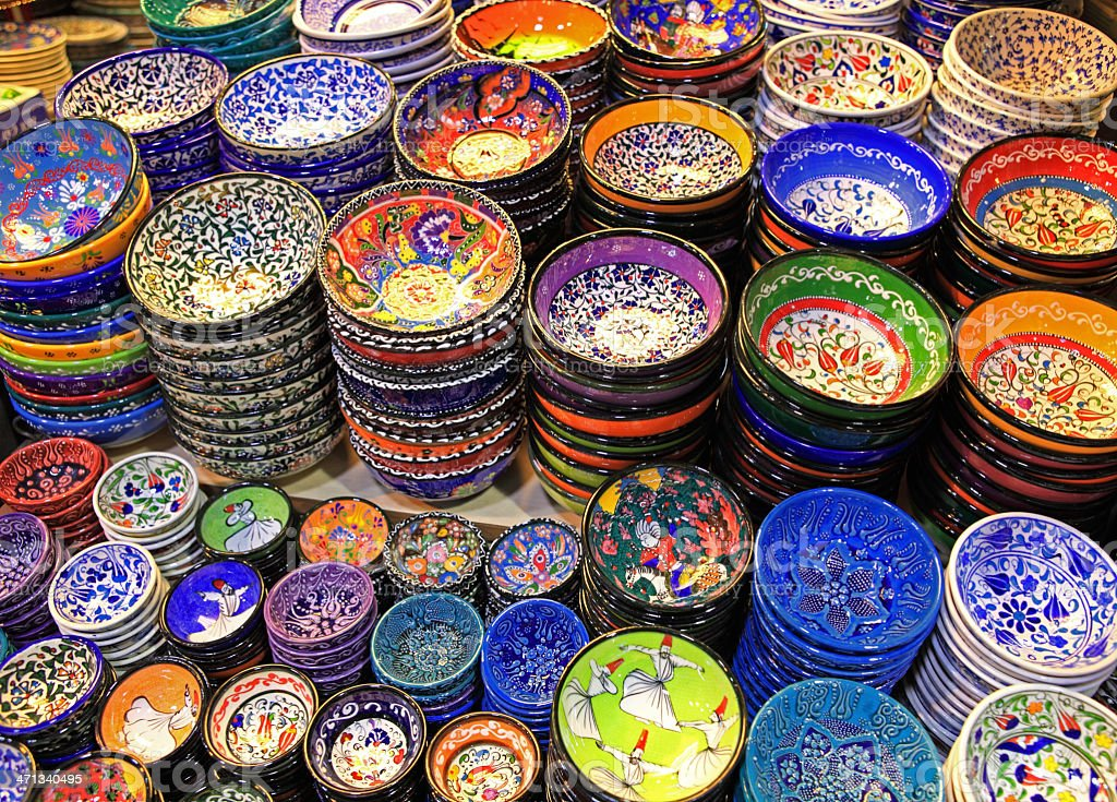 Stacks of colorful pottery plates and bowls stock photo
