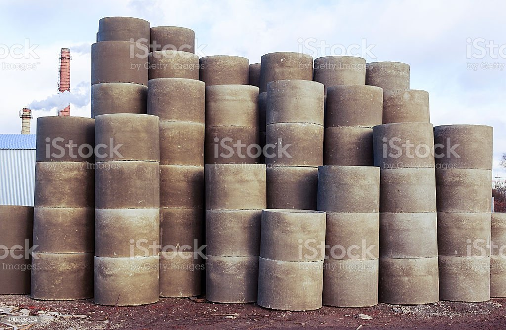 stacks of concrete rings for sewer stock photo