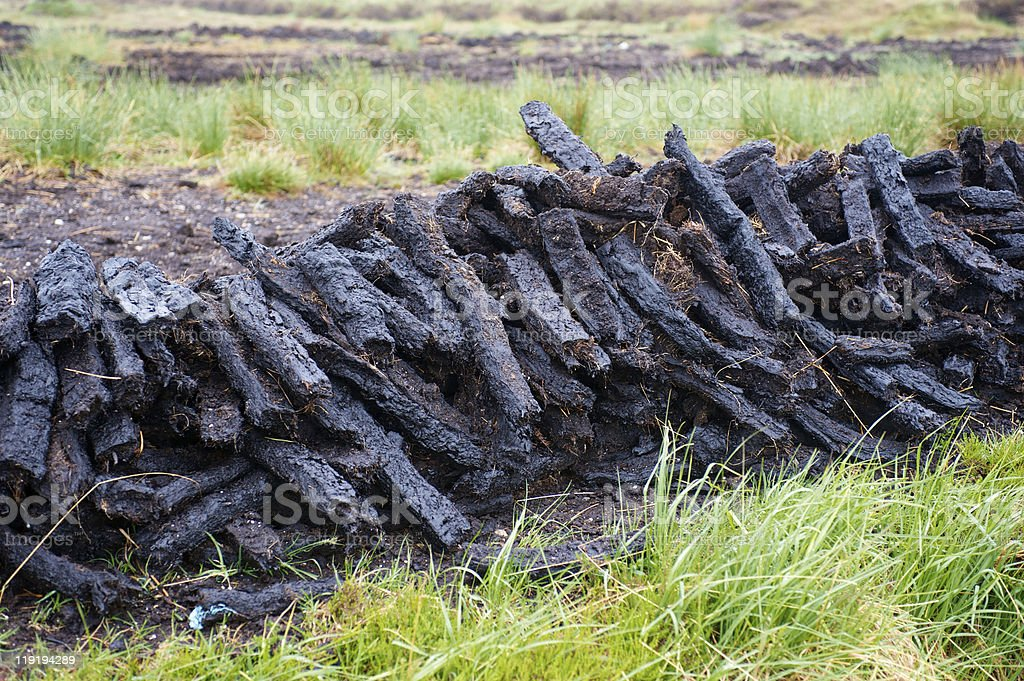 Stacks of cut Peat in moorland Ireland stock photo