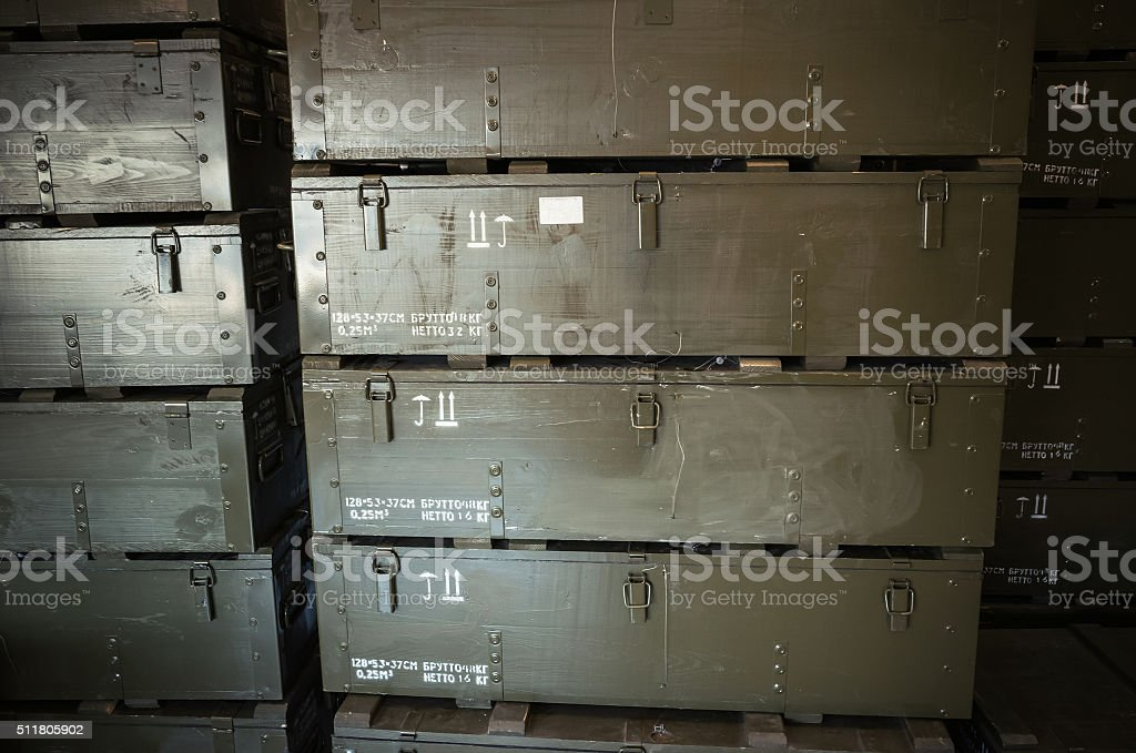 Stacks of dark green wooden boxes for ammunition stock photo
