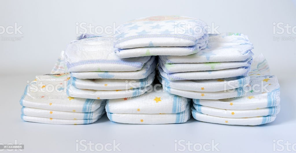 Stacks of diapers stacked in staggered rows on stock photo