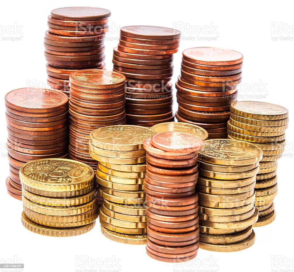 Stacks of Euro coins on white stock photo