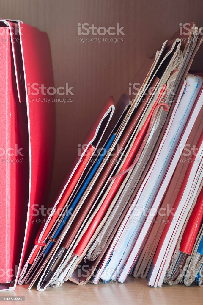 Stacks of folders with papers on the desk stock photo
