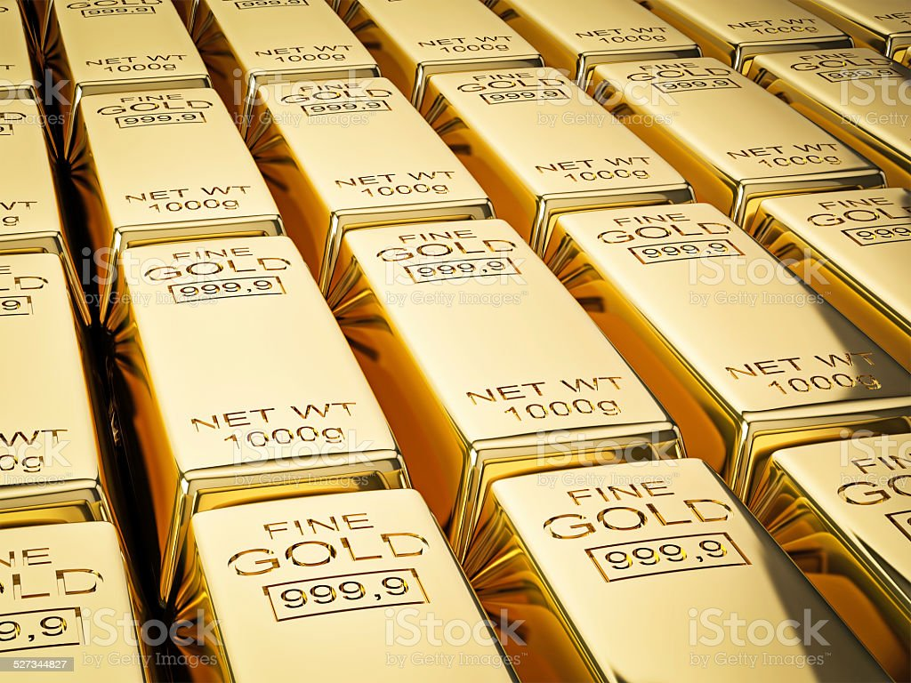 Stacks of gold bars close up stock photo