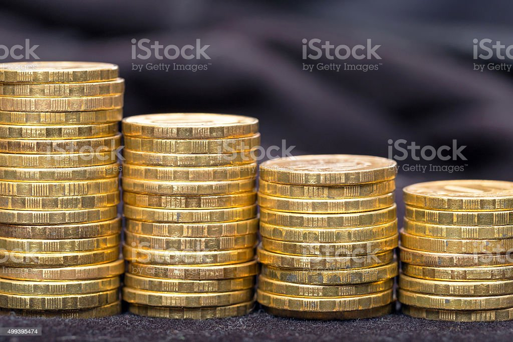 Stacks of gold coins in the form of a ladder stock photo