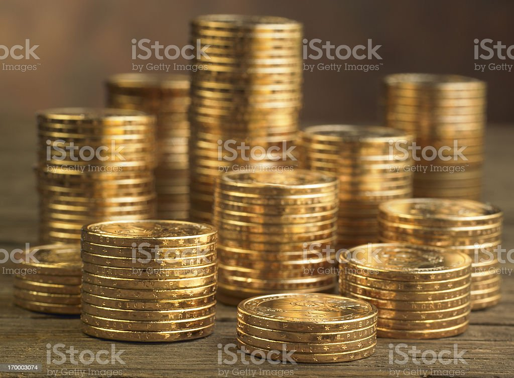 Stacks of Gold Coins on warm background royalty-free stock photo