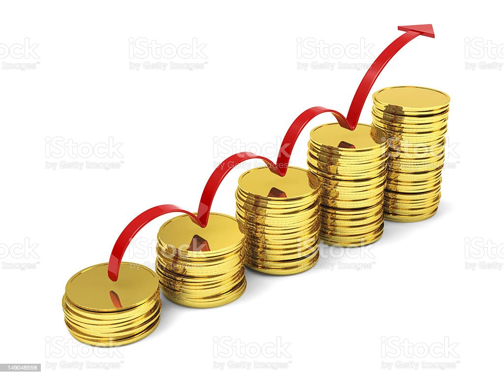 Stacks of gold coins with arrow profits stock photo