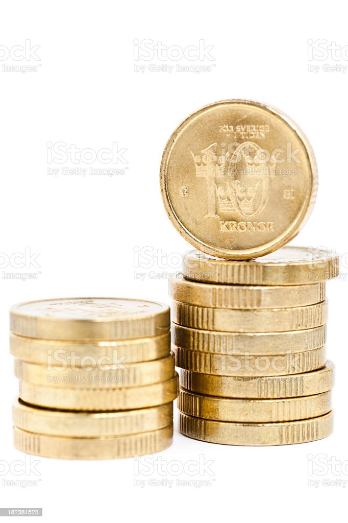 Stacks of golden Swedish coins stock photo