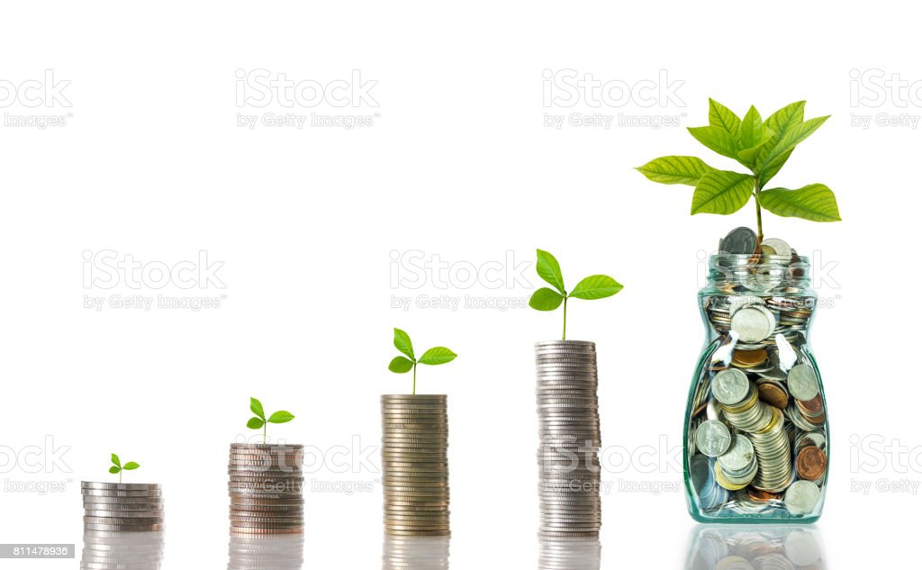 stacks of mix coins with bottle on white background, Business investment growth concept stock photo