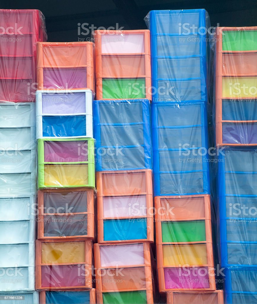 Stacks of multicolored plastic boxes. stock photo