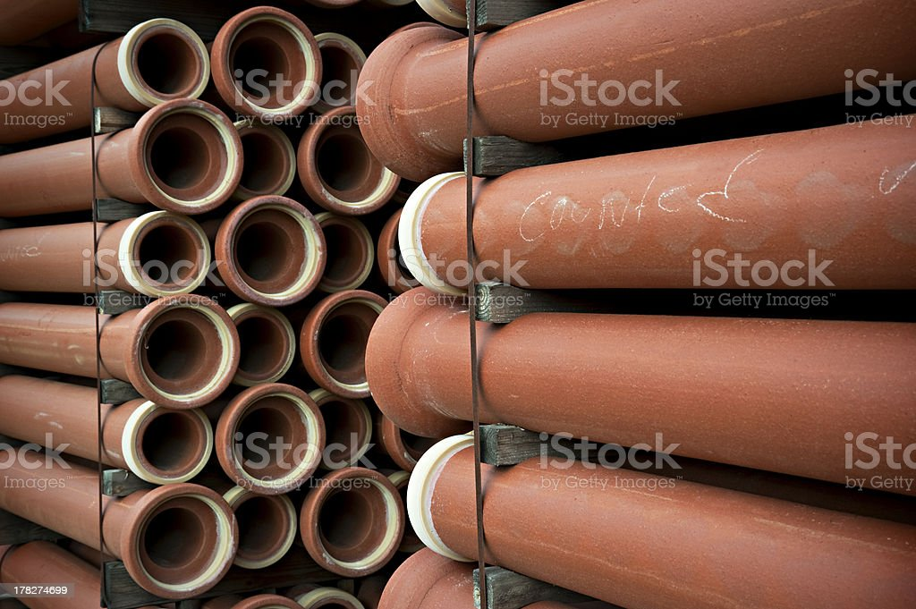 Stacks of new sewer pipes stock photo