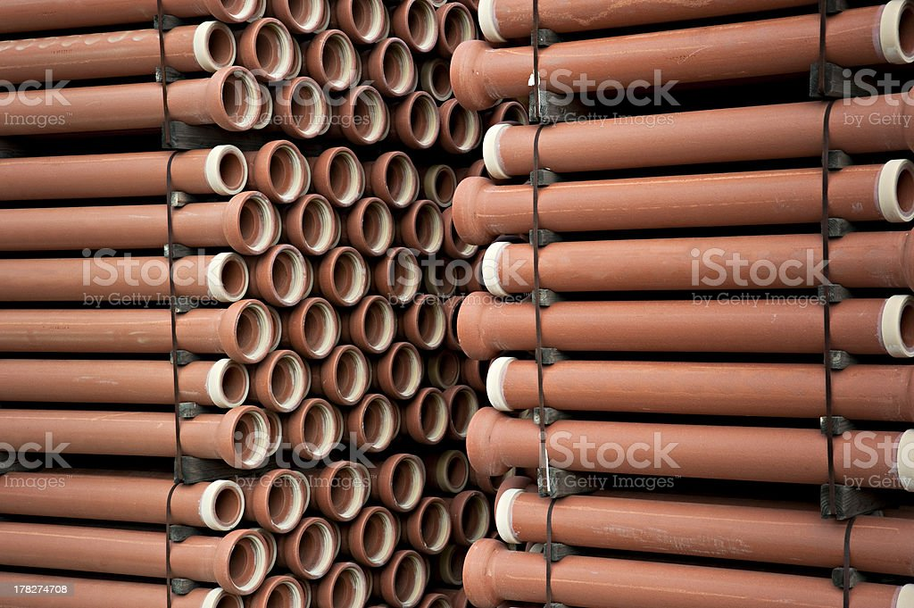 Stacks of new sewer pipes royalty-free stock photo