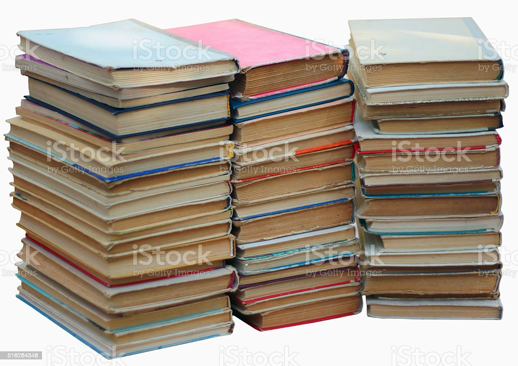 Stacks of old books isolated on white stock photo
