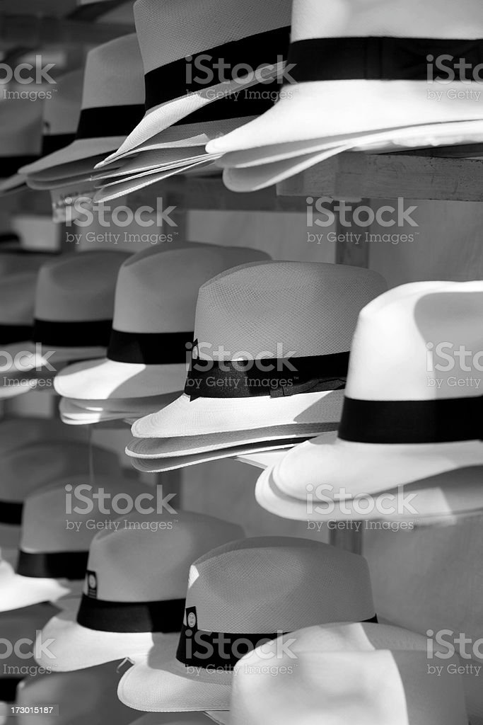 Stacks of old fashioned hats in black and white royalty-free stock photo