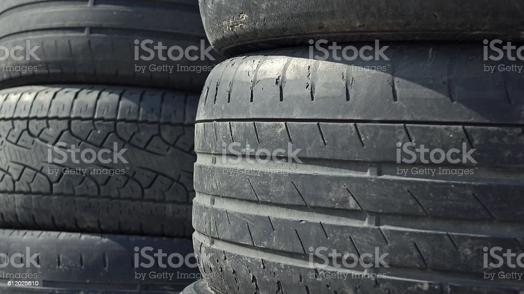 Stacks of old used car tyres. Disposal site stock photo
