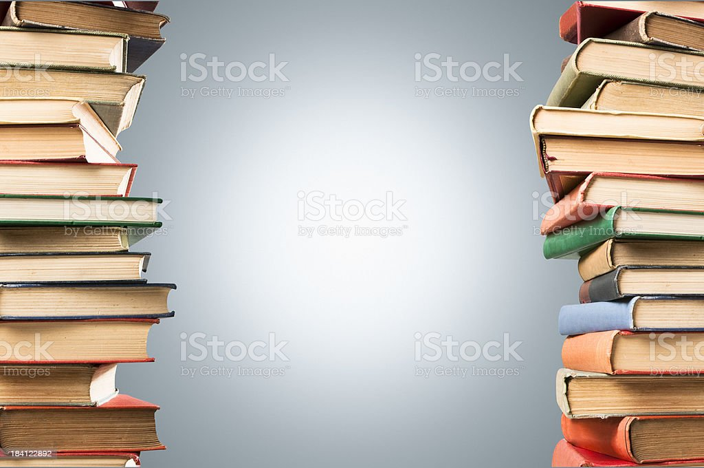 Stacks of old vintage leather bound books with copy space stock photo