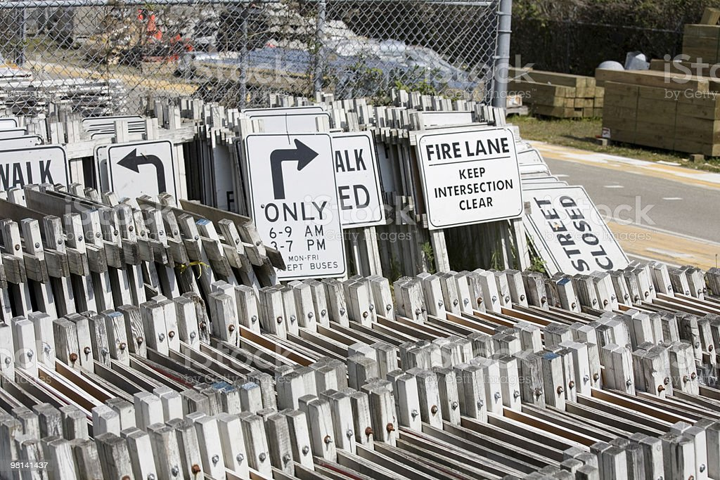 Stacks of outdoor street warning signs stock photo