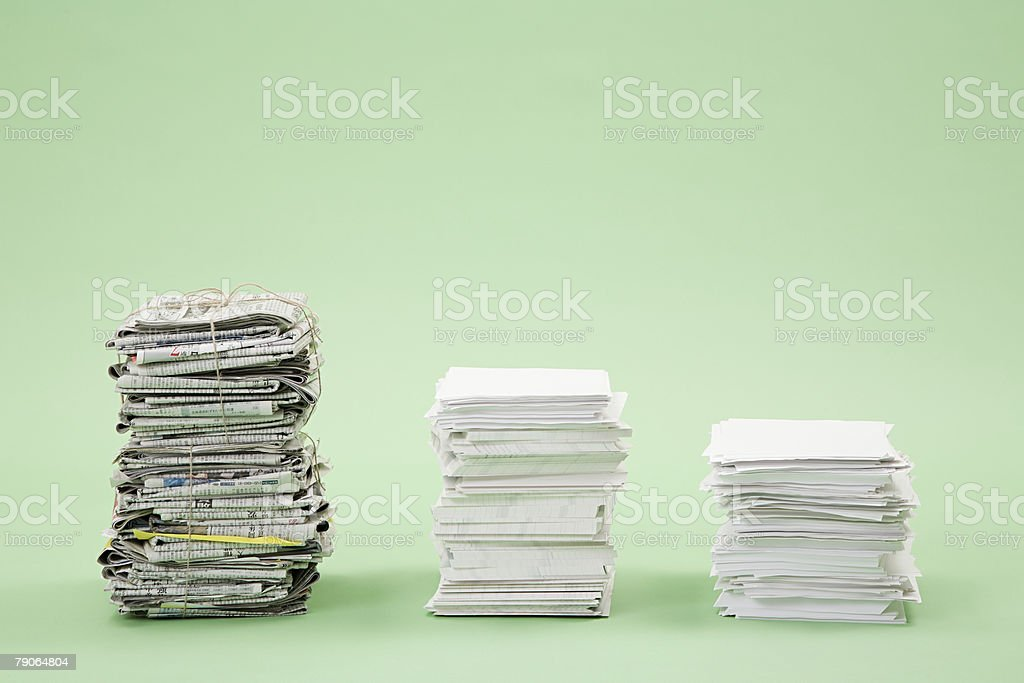 Stacks of paper and newspapers in a row royalty-free stock photo