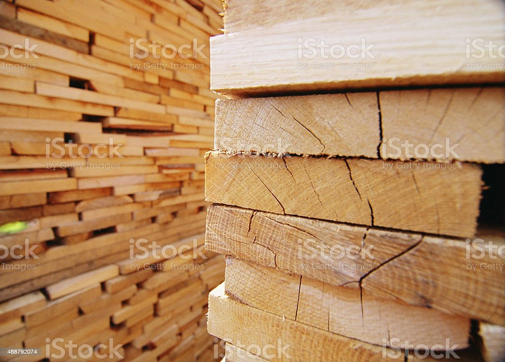 Stacks of planks of wood in a lumberyard stock photo