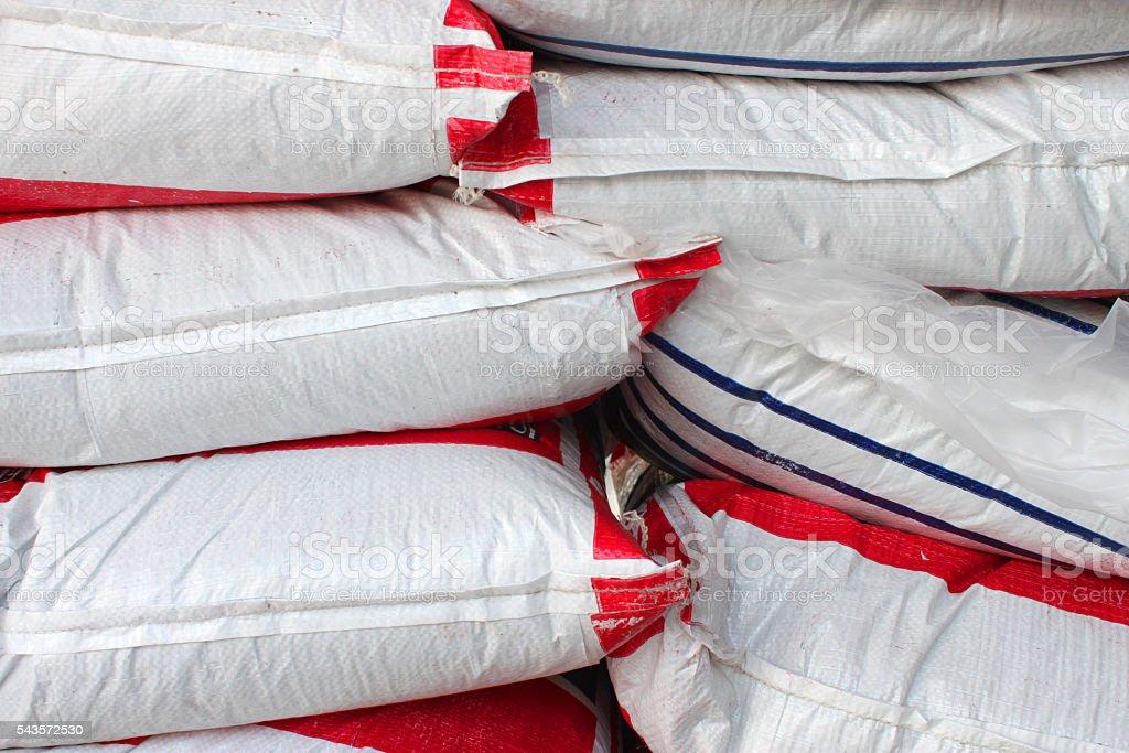stacks of plastic sacks stock photo