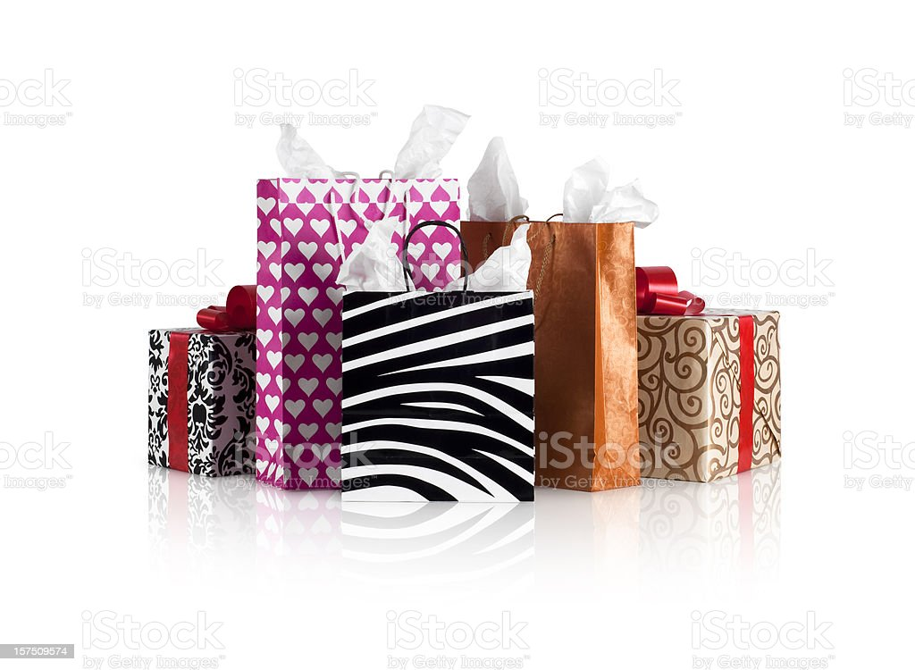 Stacks of shopping bags and gift boxes on a table  royalty-free stock photo