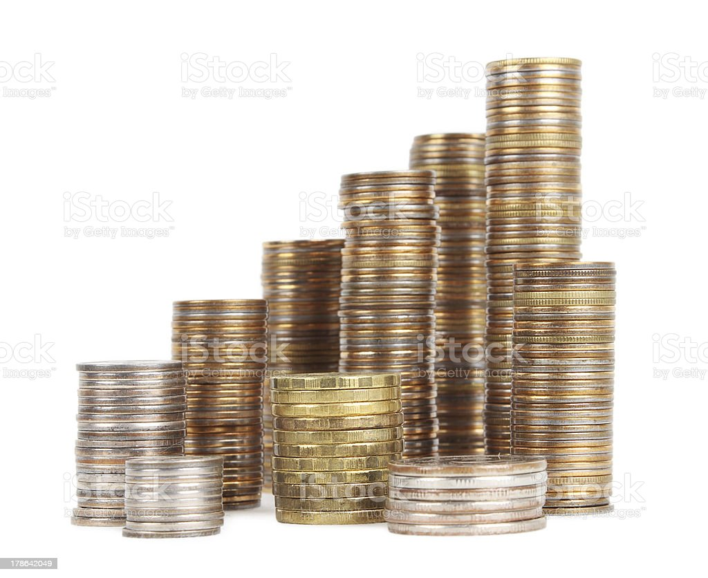 stacks of silver and golden coins isolated stock photo