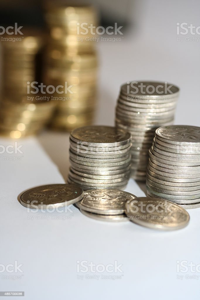 Stacks of silver five cent coins. stock photo