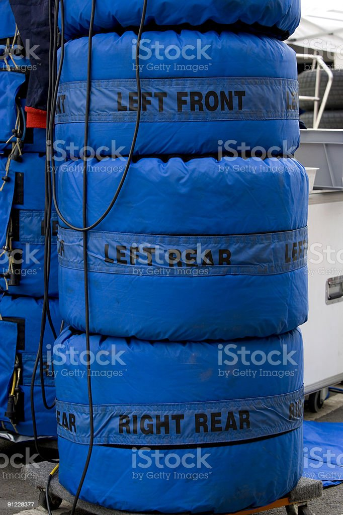 Stacks of slick racing tyres royalty-free stock photo