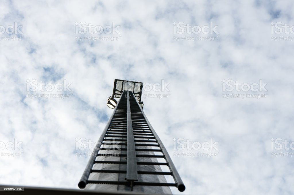 stadium light pole with cloudy sky stock photo