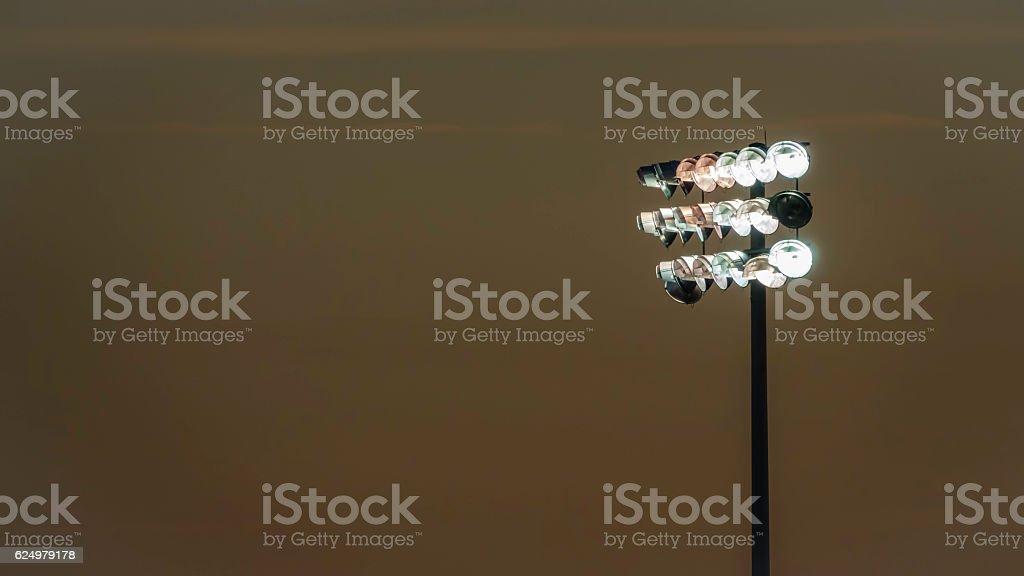 Stadium lights at dusk stock photo