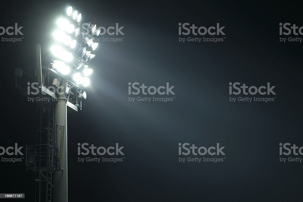 Stadium lights from side with light beams stock photo