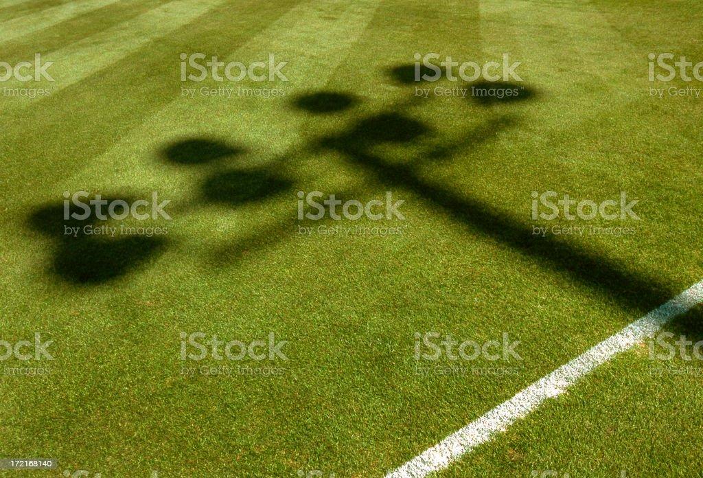 Stadium Lights shadow on playing field. royalty-free stock photo