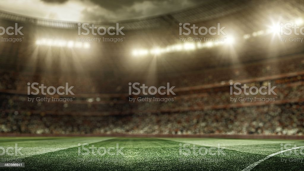 Stadium lights shining down on soccer field royalty-free stock photo
