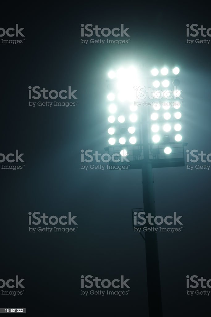 Stadium lights with copy space above - front view stock photo
